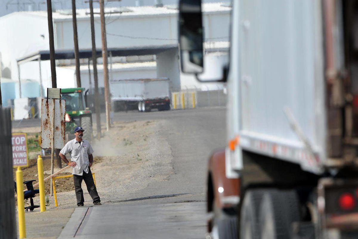 In this Tuesday, April 24, 2012, photo, a truck leaves the plant at Baker Commodities transfer station, where a cow with mad cow disease was discovered, in Hanford, Calif. The first new case of mad cow disease in the U.S. since 2006 has been discovered in