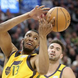Utah Jazz center Tony Bradley (13) misses the rebound as Utah Jazz forward Georges Niang (31) watches during an NBA game against the San Antonio Spurs at Vivint Arena in Salt Lake City on Friday, Feb. 21, 2020. The Jazz lost 104-113.