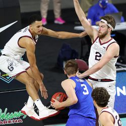Brigham Young Cougars forward Matt Haarms (3) tries to get up a shot with Gonzaga Bulldogs guard Jalen Suggs (1) and Gonzaga Bulldogs forward Drew Timme (2) defending him as BYU and Gonzaga play in the finals of the West Coast Conference tournament at the Orleans Arena in Las Vegas on Tuesday, March 9, 2021. Gonzaga won 88-78.