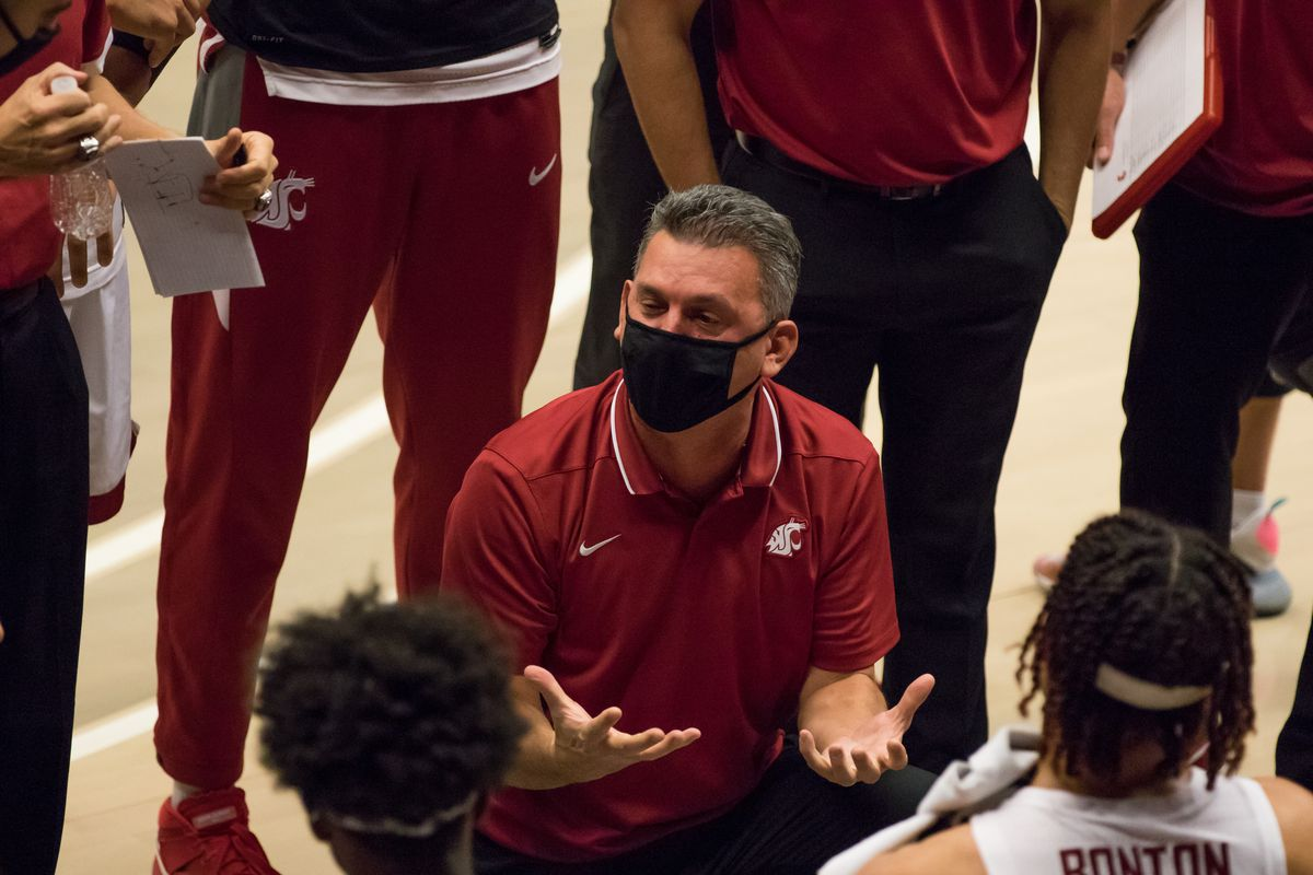PULLMAN, WA - DECEMBER 9: Washington State head coach Kyle Smith talks to his team during a media timeout of the Battle of the Palouse rivalry between the Idaho Vandals and the Washington State Cougars on December 9, 2020, at Beasley Coliseum in Pullman, WA.