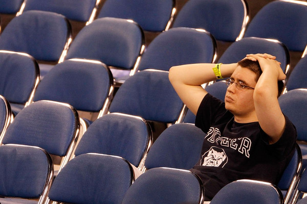 INDIANAPOLIS - APRIL 05:  A fan of the Butler Bulldogs looks on dejected after the Duke Blue Devils won 61-59 during the 2010 NCAA Division I Men's Basketball National Championship game at Lucas Oil Stadium on April 5, 2010 in Indianapolis, Indiana.