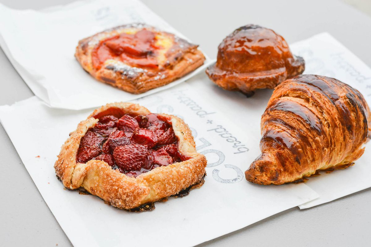 Pastries from Colossus Bread in San Pedro, arranged on a table.
