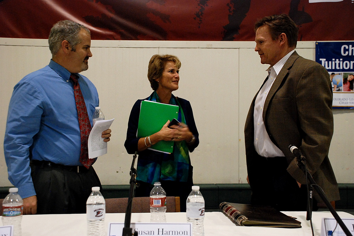 School board recall candidates Matthew Dhieux and Susan Harmon chat with incumbent John Newkirk after a candidate forum.