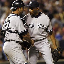 New York closer Mariano Rivera, right, is congratulated by catcher Jorge Posada after closing out the Orioles on Wednesday.
