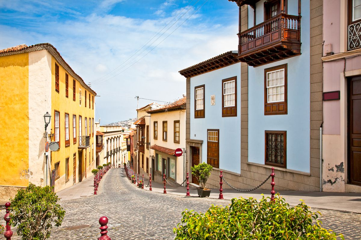 Colorful houses line a street in Tenerife.
