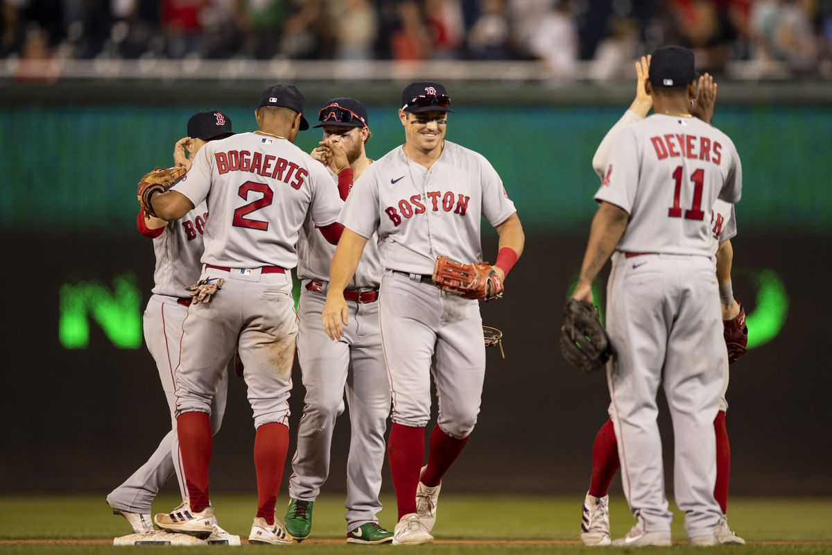 Members of the Boston Red Sox celebrate their victory against the Washington Nationals on October 2, 2021 at Nationals Park in Washington, DC.