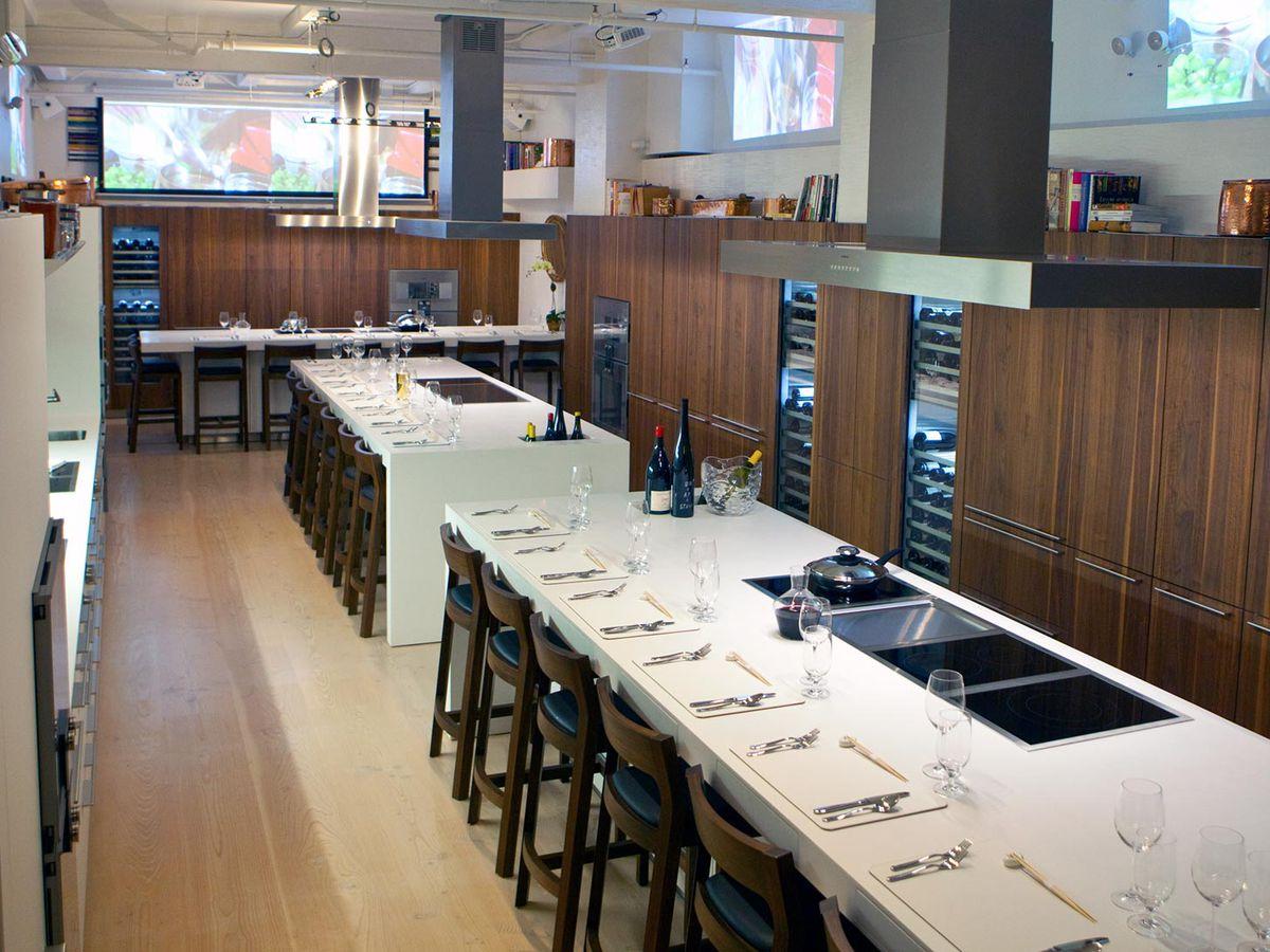 A white restaurant countertop set up for dinner