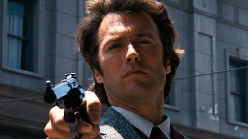 A man points a gun.