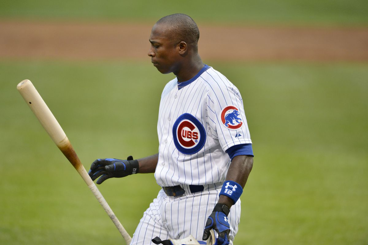Alfonso Soriano of the Chicago Cubs flips his bat after striking out against the San Francisco Giants at Wrigley Field in Chicago, Illinois.  (Photo by Brian Kersey/Getty Images)