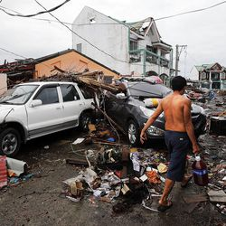 Debris covers many streets in Tacloban, Friday, Nov. 22, 2013.