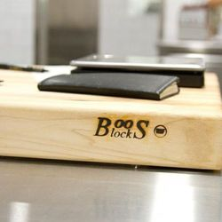 Each cook has his or her own fancy Boos block, and is responsible for washing, treating, and storing it at built-in slots at each station.