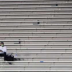 A Brigham Young Cougars fan sits in the stands before the start of an NCAA football game at LaVell Edwards Stadium in Provo on Saturday, Oct. 31, 2020.