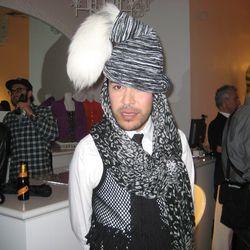 Mondo models a hat he bought in Barcelona.