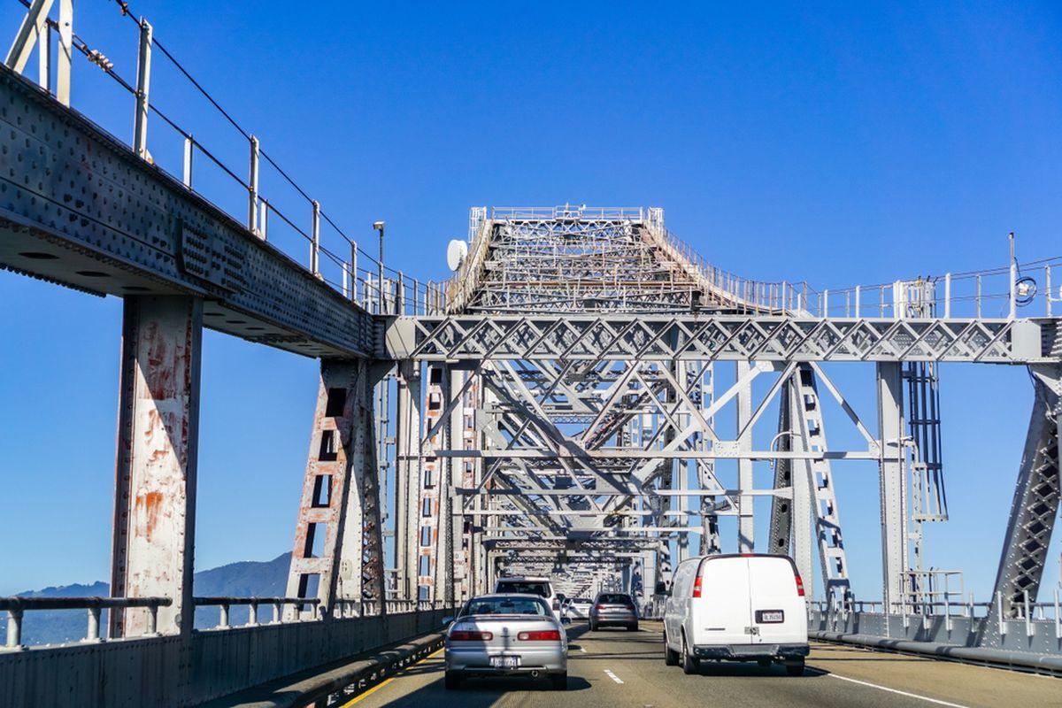 A photo of cars approaching the Richmond-San Rafael bridge.