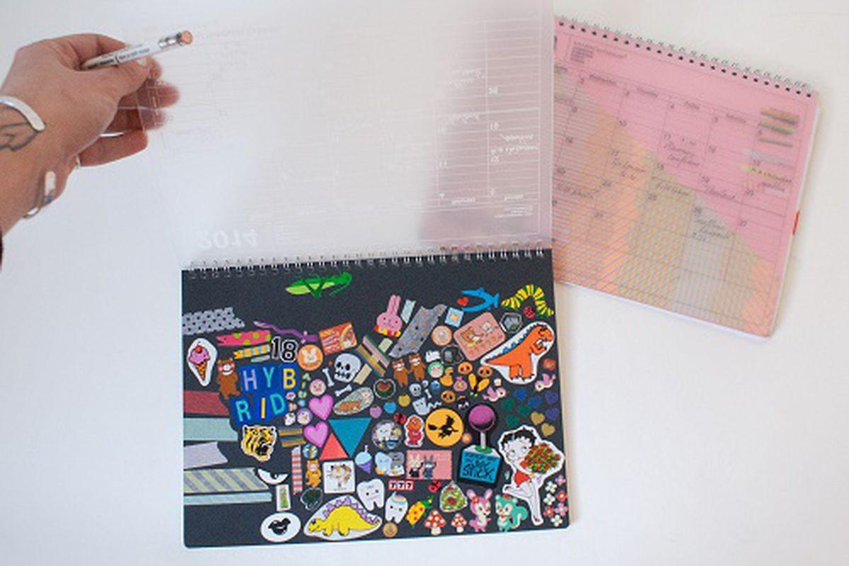 "Omoi web coordinator Maggie decorates her calendar with stickers. Image credit: <a href=""http://omoionline.com/index.php/marks-notebook-calendar-2014-custom/"">Omoi Zakka Shop</a>"