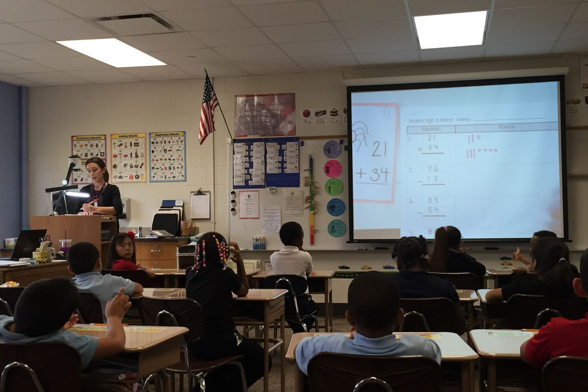 Natalie Shaw checks subtraction and addition problems with her second-graders at IPS School 61. The school is part of the district's pilot in racial equity training.