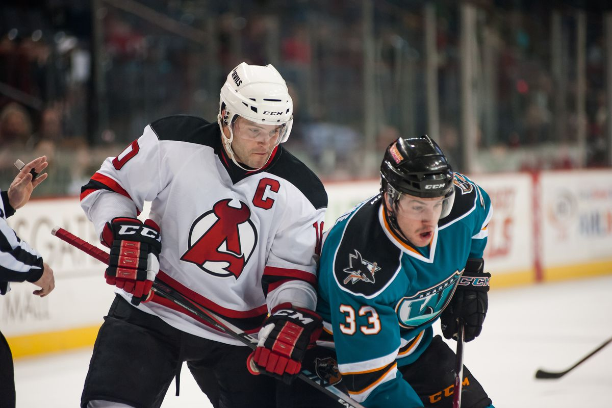 Worcester Sharks forward Chris Crane battles against Albany Devils captain Rod Pelley during Friday night's game at the Times Union Center (www.flickr.com/photos/albanydevils).