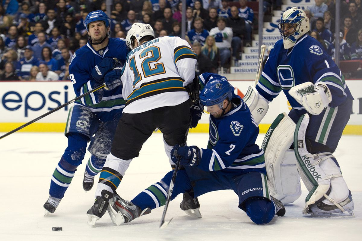 Kevin Bieksa is about to show that milk hotdog Patrick Marleau what time it is.