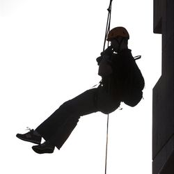 Dan Monk, a Senior Mechanical Engineering Student at BYU, ascends the Provo City Fire Tower with a winch developed by the his BYU Capstone Team, March 28, 2012.