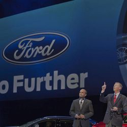 """Raj Nair, group vice President global product development, left, Alan Mulally, President and CEO of Ford Motor Company, center, and Stephen Odel, chairman and CEO Ford Europe, from left to right, gesture during a presentation of fresh Ford models in Amsterdam, Netherlands, Thursday Sept. 6, 2012. Ford has unveiled 15 new or restyled vehicles for the European market that it will launch over five years to revive sales. The refreshed lineup announced Thursday includes a second-generation Kuga midsize SUV to be launched this year, as well as a new Ecosport compact SUV and the European launch of the larger Edge. Ford also will launch the iconic Mustang in Europe. Ford Europe CEO Stephen Odell said improvements in the """"brutal"""" European market are not expected soon. Ford, he said, is increasing its investment in Europe to be ready when the market bounces back."""