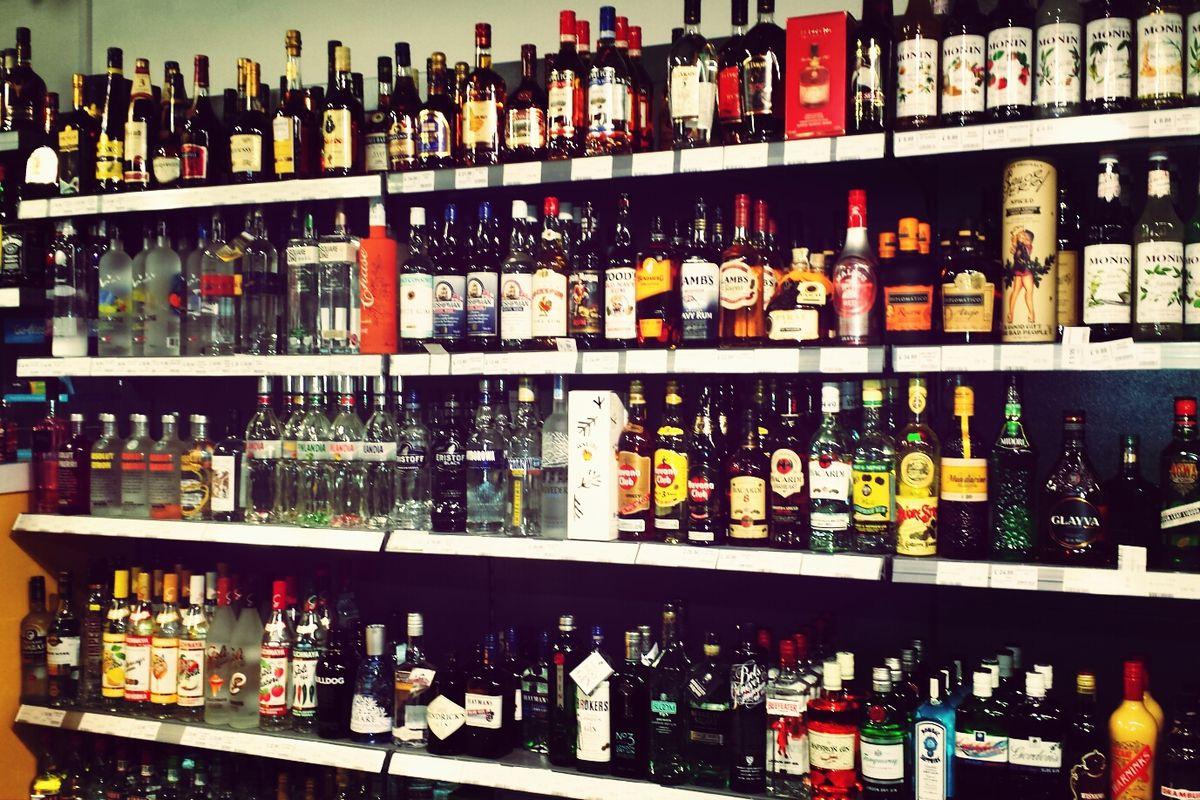 Bottles of liquor on store shelves.