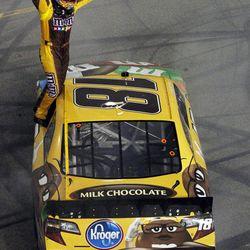 Kyle Busch celebrates winning the NASCAR Sprint Cup Series auto race at Richmond International Raceway in Richmond, Va., Saturday, April 28, 2012.