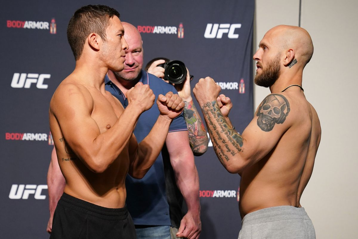 Opponents Hunter Azure and Brian Kelleher face off during the official UFC Fight Night weigh-in on May 12, 2020 in Jacksonville, Florida.