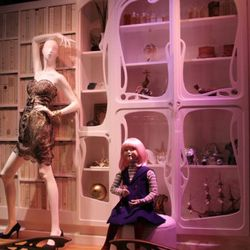 """Here's our star, the little girl, with the """"cabinet of curiosities"""" behind her"""