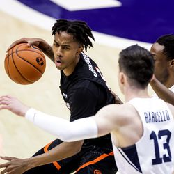 Pacific Tigers guard Daniss Jenkins (4) drives against Brigham Young Cougars guard Alex Barcello (13) and guard Brandon Averette (4) at the Marriott Center in Provo on Saturday, Jan. 30, 2021.