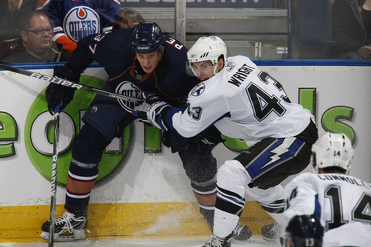 EDMONTON CANADA - SEPTEMBER 23:  Richard Petiot #37 of the Edmonton Oilers  battles against James Wright #43 ofthe Tampa Bay Lightning on September 23 2010 at Rexall Place in Edmonton Alberta Canada. (Photo by Dale MacMillan/Getty Images)