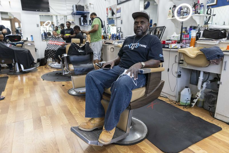 Marvin Washington poses for a portrait at Blues Barber Shop at 1376 E 53rd St in Hyde Park, Friday, June 11, 2021.