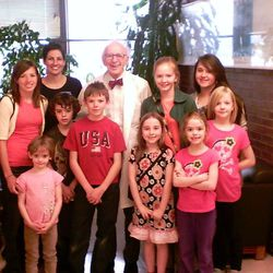 Nobel Prize Laureate Eric Kandel with homeschool co-op children. Olive Ward is in front wearing a black and red dress.