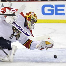 Florida Panthers goalie Scott Clemmensen reaches to make a save on a shot by New Jersey Devils' David Clarkson during the second period of Game 6 of a first-round NHL hockey Stanley Cup playoff series, Tuesday, April 24, 2012, in Newark, N.J.