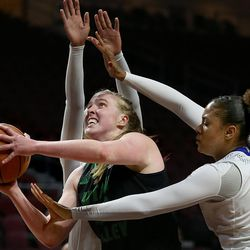 Utah Valley University Wolverines center Sam Lubcke (40) drives past Cal State Bakersfield Roadrunners forward Erika Williams (15) and Cal State Bakersfield Roadrunners forward Tylinn Carter (23) in the 2017 WAC Tournament quarterfinals at Orleans Arena in Las Vegas on Wednesday, March 8, 2017.