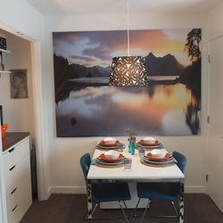 This nook seemed like the natural place in the apartment for a bed, but the Ikea home tour team amazingly found a new home for the bed and turned this corner into an entertaining space. A large piece of artwork hung almost to the edge of the wall captures