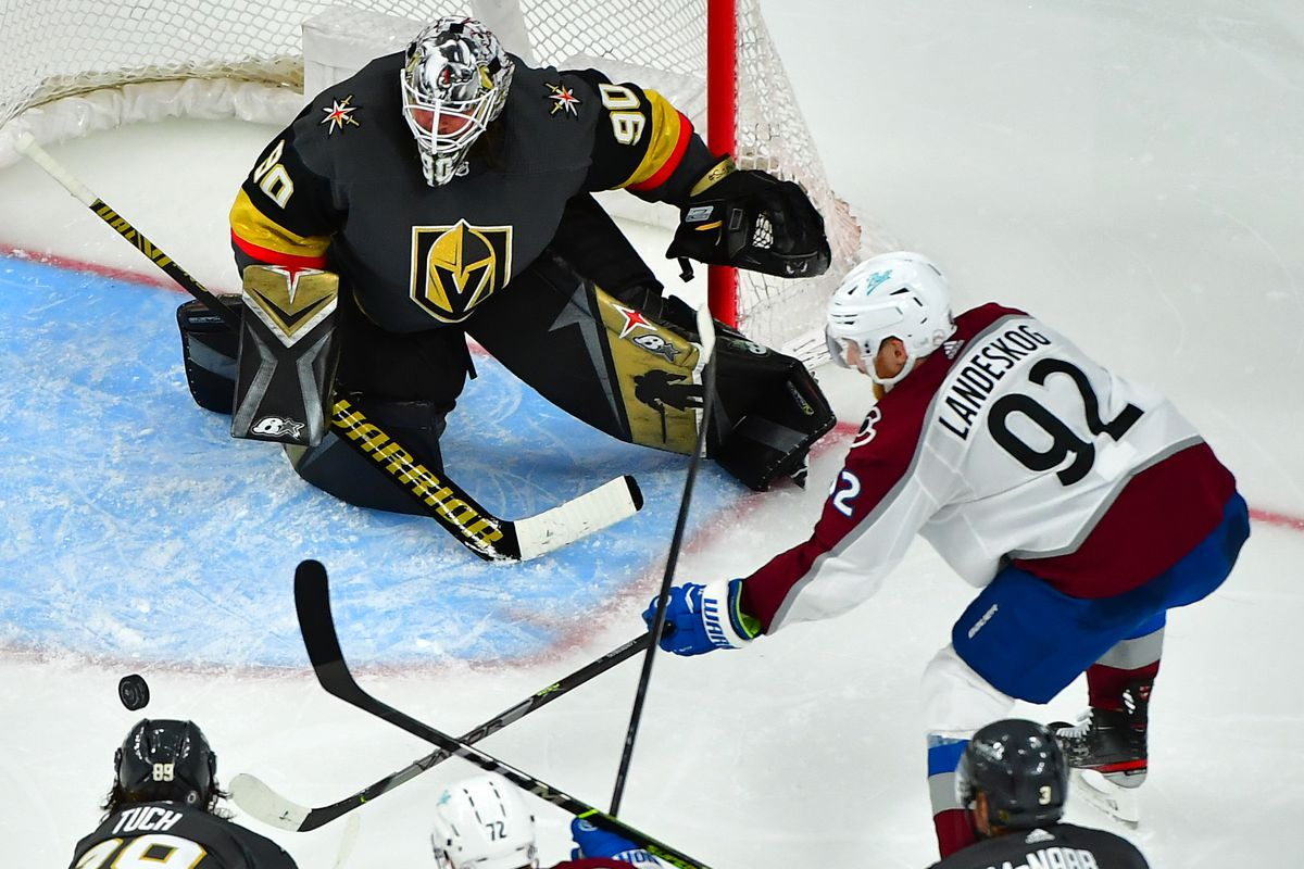 Colorado Avalanche left wing Gabriel Landeskog (92) makes a pass through the slot in front of Vegas Golden Knights goaltender Robin Lehner (90) during the third period at T-Mobile Arena.
