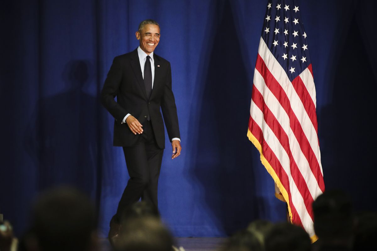 Former President Barack Obama prepares to speak to students at the University of Illinois.