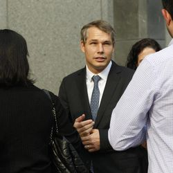 """Shepard Fairey, center, arrives at Manhattan Federal court, Friday, Sept. 7, 2012 in New York.  The artist who created the """"HOPE"""" poster that came to symbolize Barack Obama's 2008 presidential campaign will be sentenced Friday, with prosecutors seeking a prison sentence for his criminal contempt conviction and his lawyers arguing that he should face no prison time for the misdemeanor charge."""