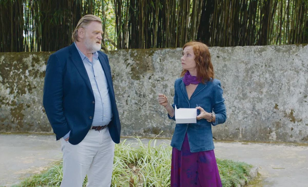 Gleeson and Huppert have a conversation in a garden.