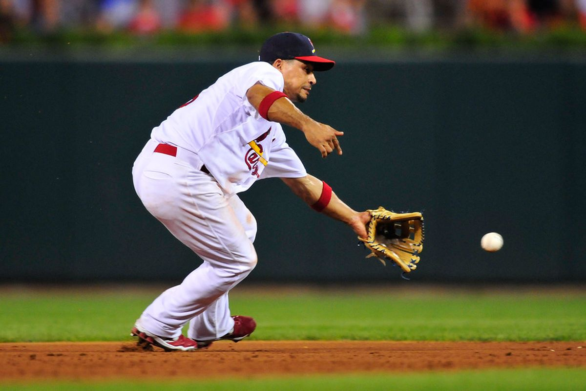 ST. LOUIS, MO - AUGUST 14: Rafael Furcal #15 of the St. Louis Cardinals fields a ground ball against the Colorado Rockies at Busch Stadium on August 14, 2011 in St. Louis, Missouri.  (Photo by Jeff Curry/Getty Images)