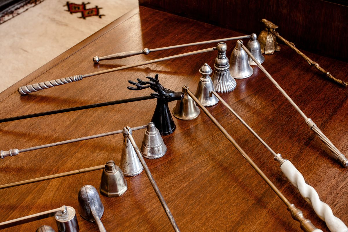 A row of candle snuffers became a decorative moment when grouped together.
