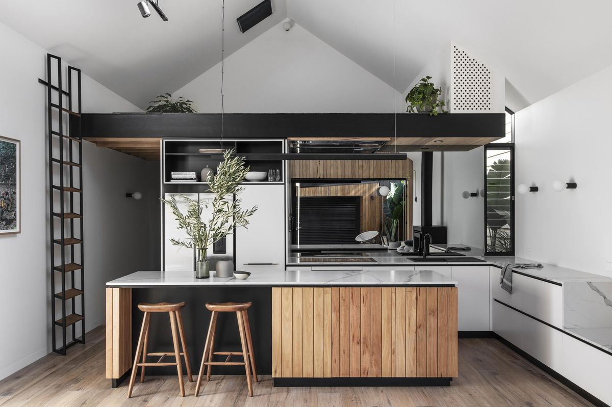 Black, white, and wood kitchen with large island.