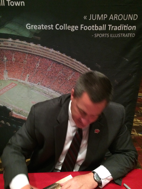 Coach Chryst signing a football