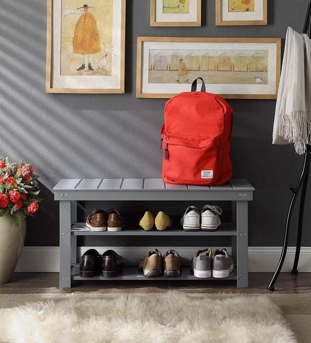 Gray bench with shelves underneath.
