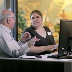 Roger Grua, left, and Beth Taylor, US and Canada Research Specialist, work in the US and Canada Research Specialists Office at the Church of Jesus Family History Library -Christ of Latter-day Saints in Salt Lake City on Tuesday, July 6, 2021. The library reopened after being closed for 16 months.