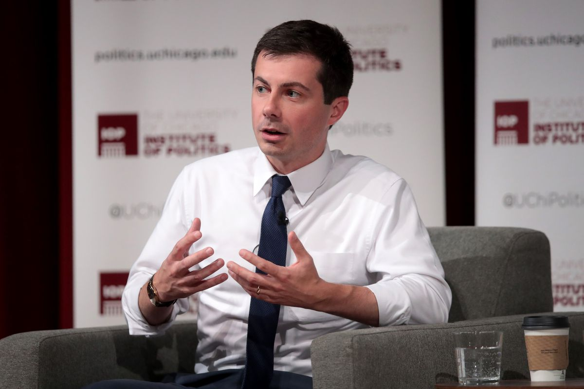 Democratic presidential candidate South Bend, Indiana, Mayor Pete Buttigieg sitting onstage and speaking to the audience.