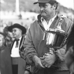 BYU head football coach LaVell Edwards receives the runner-up trophy in the Fiesta Bowl in December 1974.