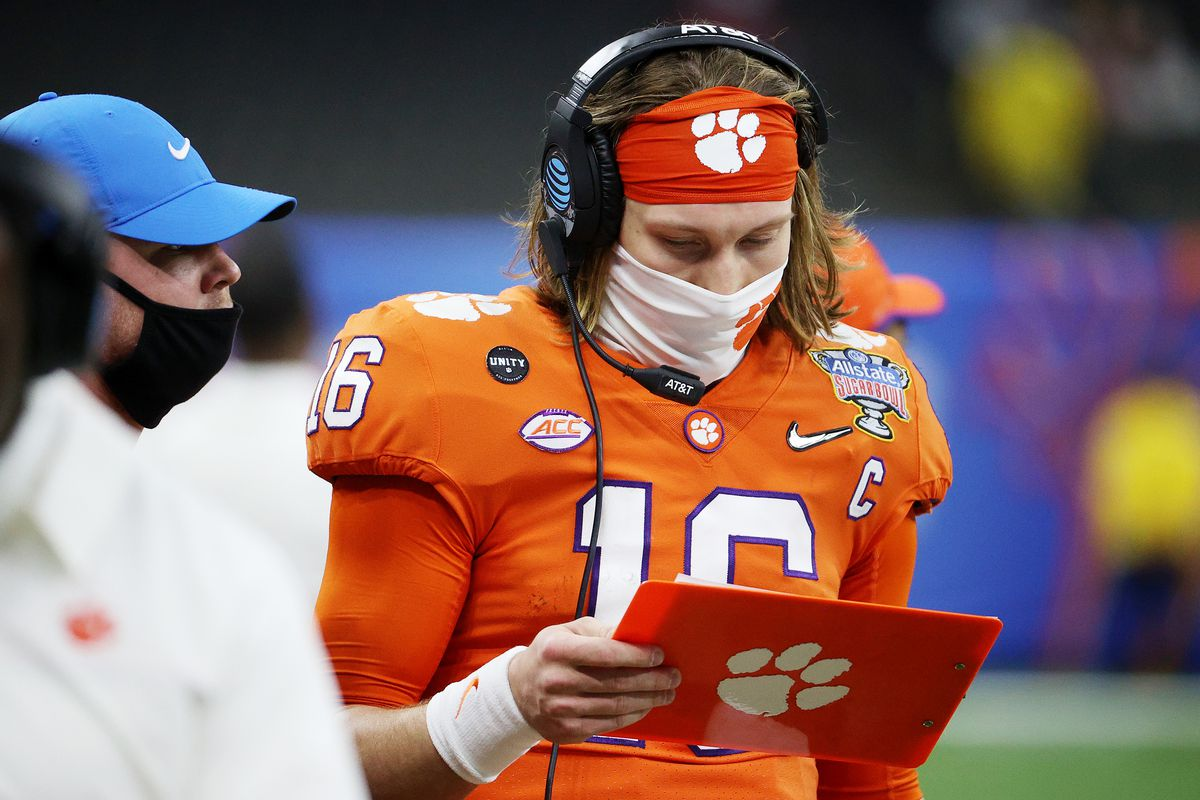 Trevor Lawrence #16 of the Clemson Tigers stands on the sideline in the first half against the Ohio State Buckeyes during the College Football Playoff semifinal game at the Allstate Sugar Bowl at Mercedes-Benz Superdome on January 01, 2021 in New Orleans, Louisiana.