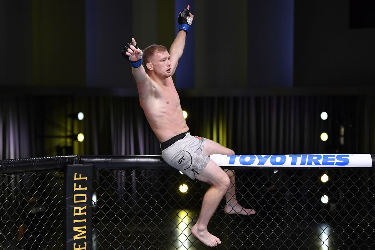 Casey Kenney celebrates after his submission victory over Louis Smolka in their bantamweight fight during the UFC Fight Night event at UFC APEX on May 30, 2020 in Las Vegas, Nevada.