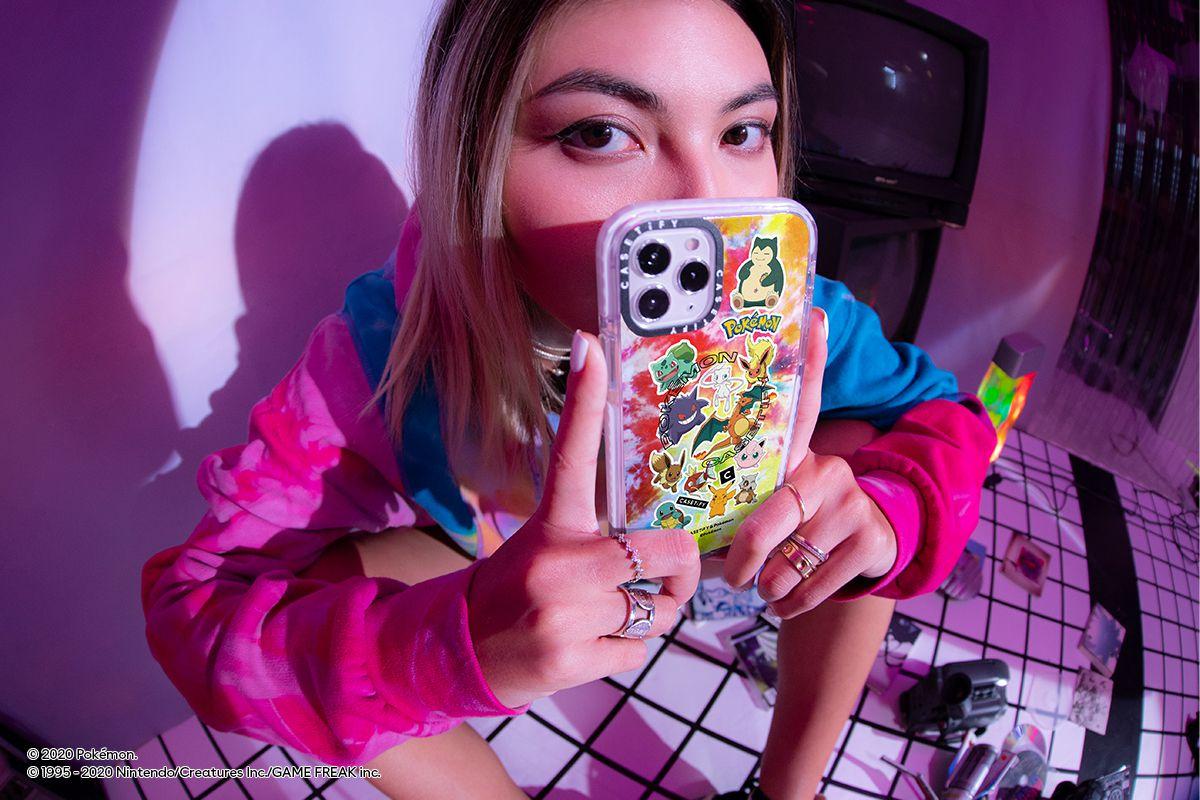 A model holds a tie-dye Casetify x Pokémon phone case